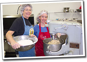 'Aunt Sue' and Amy making Jed's Maple Bread